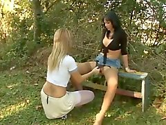 Carla Novaes drills a chick outdoors