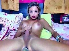Gorgeous transsexual toys her big ram rod