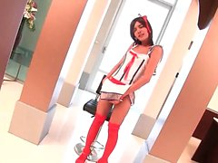 Asian shemale in uniform stripping