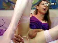 milf shemale in white stockings gets anal orgasm with dildo on cam